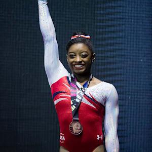 Simone Biles smiles on the vault podium at the 2015 Worlds (John Cheng/USA Gymnastics)