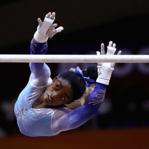 Simone Biles transitions from the low bar during the uneven bars final at the 2018 Worlds