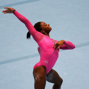 Simone Biles smiles during her gold medal-winning floor routine at the 2013 Worlds.