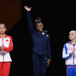 2019 all-around podium (L-R): runner-up Tang Xijing, winner Simone Biles, bronze medallist Angelina Melnikova