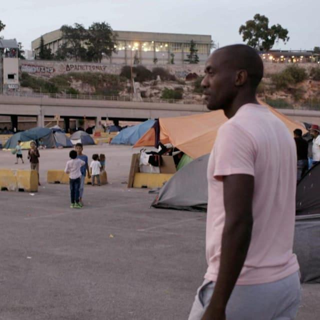 Olympic rowing champion Sizwe Ndlovu visits refugees in Greece