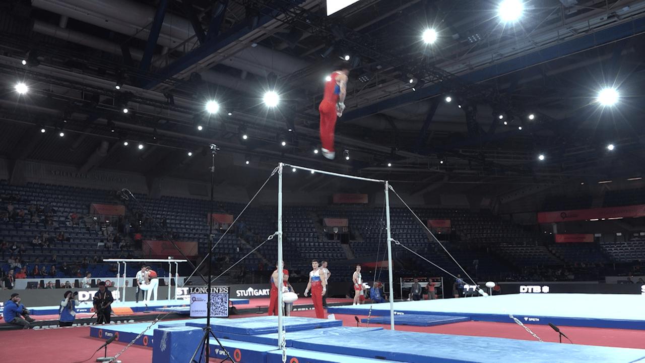 Russian men on horizontal bar in podium training