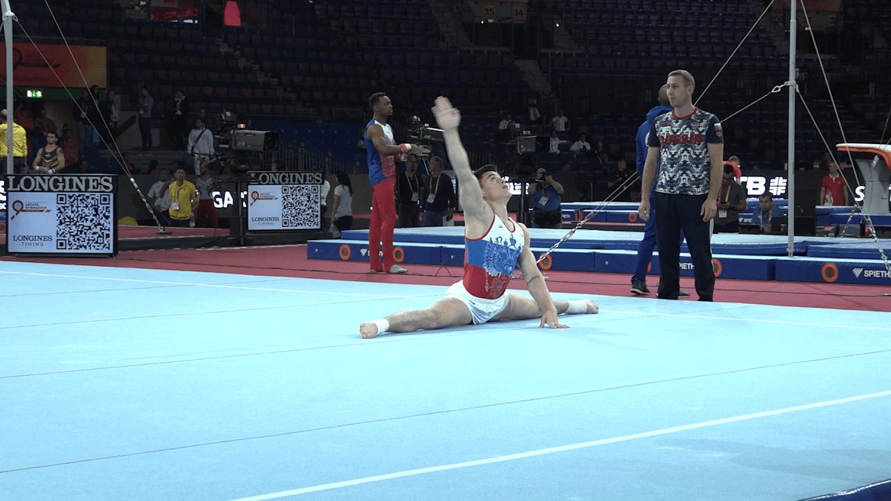 Nikita Nagornyy practices on floor in podium training