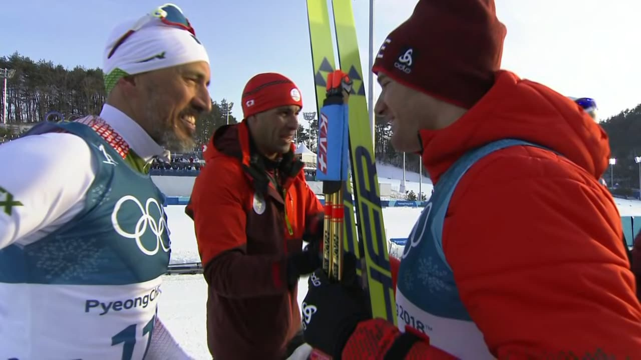 Champion Cologna congratulates last finisher Madrazo