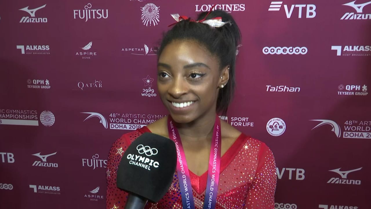 Simone Biles pleased for teammates after world title