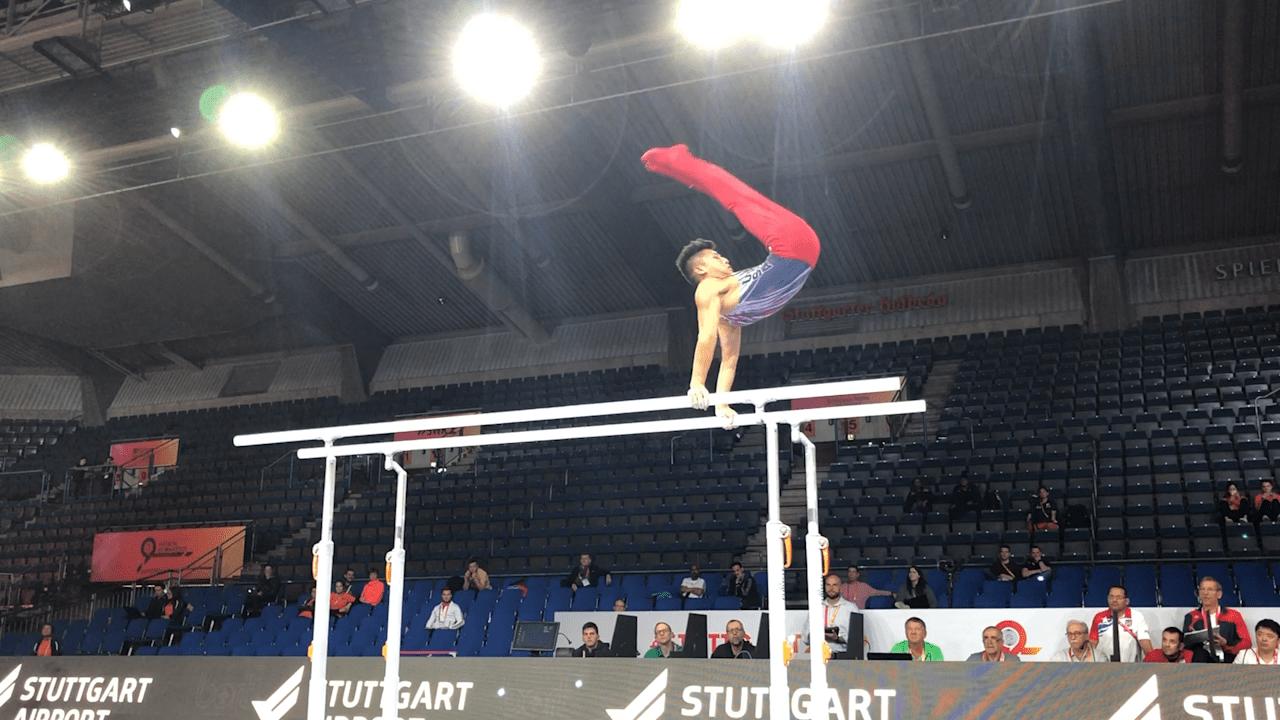 Yul Moldauer on parallel bars in podium training