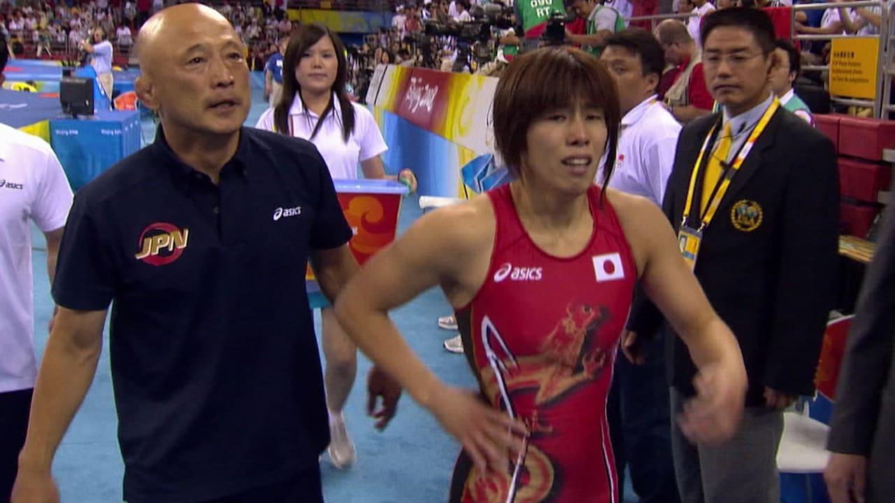 Yoshida pins Xu to retain Olympic title