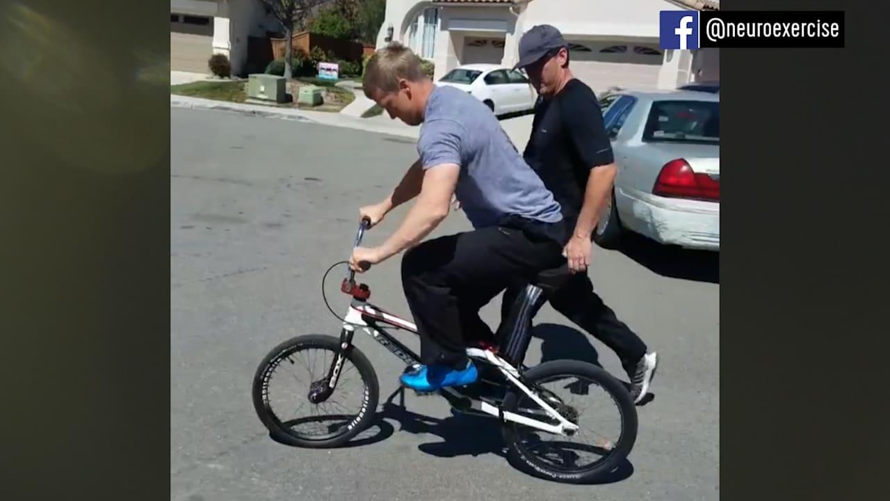 Paralysed BMX star back on his bike!