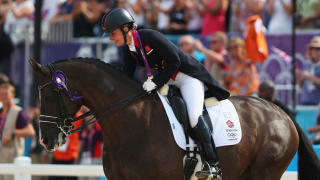Charlotte Dujardin hugs her horse Valegro, celebrating with her gold medal during the medal ceremony following the Individual Dressage on Day 13 of the London 2012 Olympic Games.
