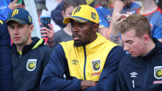 Usain Bolt watches Central Coast's A-League trial match with Newcastle from the bench