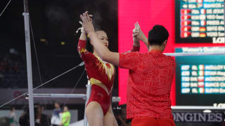 Chen Yile celebrates with her coach after uneven bars at the 2019 World Championships (Photo: Olympic Channel)