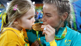 Nicole Beck of Australia kisses her Gold medal with her daughter Sophie Beck after the medal ceremony for the Women's Rugby Sevens on Day 3 of the Rio 2016 Olympic Games.