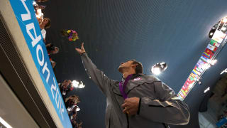 Michael Phelps throws his ceremonial flowers to his mother Debbie Phelps following the medal ceremony for the Men's 4x100m medley Relay Final on Day 8 of the London 2012 Olympic Games.