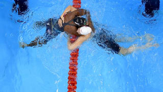 Simone Manuel of the United States (L) embraces Penny Oleksiak of Canada after winning gold in the Women's 100m Freestyle Final on Day 6 of the Rio 2016 Olympic Games.