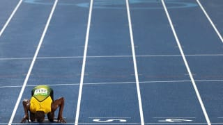 Usain Bolt celebrates winning the Men's 200m Final by kissing the track on Day 13 of the Rio 2016 Olympic Games.