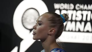 Angelina Melnikova poses by sticking her tongue out at the 2019 World Championships (Photo: Olympic Channel)