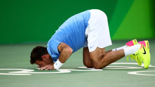 Juan Martin  kisses the court after defeating Rafael Nadal of Spain in the Men's Singles Semifinal Match on Day 8 of the Rio 2016 Olympic Games.