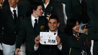 Damien Hooper of Australia displays the message 'I love you Nan' as he parades around the stadium with the rest of the Australia team during the Opening Ceremony of the London 2012 Olympic Games.
