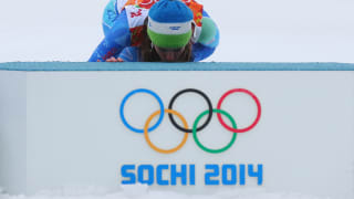 Tina Maze of Slovenia kisses the podium in celebration during the flower ceremony for the Alpine Skiing Women's Giant Slalom on day 11 of the Sochi 2014 Winter Olympics.
