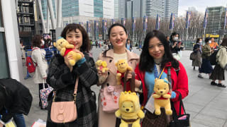 Yuzuru Hanyu fans pose with Pooh toys at the World Figure Skating Championships