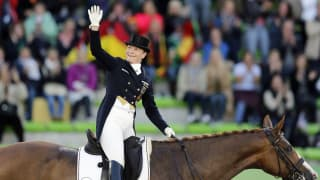 Isabell Werth - Germany's Werth riding Bella Rose 2 celebrates during the Team Competition Dressage qualifier for the Grand Prix Special at the World Equestrian Games at the d'Ornano stadium in Caen