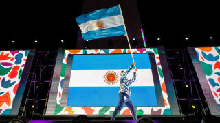 Dante Cittadini, Sailing, carries the national flag of Argentina during the flag parade at the Opening Ceremony.