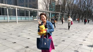 A Yuzuru Hanyu fan poses with a Pooh toy at the World Figure Skating Championships