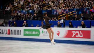 Evgenia Medvedeva performs a jump during her bronze medal free skate