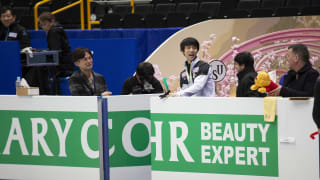 Hanyu shares a joke with coach Brian Orser in practice