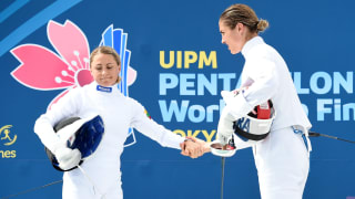 Laura Asadauskaite (L) shakes hands with Elodie Clouvel after their Fencing bout