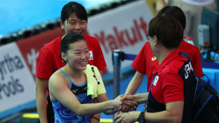 Sayaka Mikami of Japan celebrates her qualification with her team after the Women's 3m Springboard Semifinal on day seven of the Gwangju 2019 FINA World Championships at Nambu International Aquatics Centre on July 18, 2019 in Gwangju, South Korea. (Photo by Clive Rose/Getty Images)