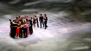 The skaters embrace on ice as the World Figure Skating Championships gala concludes (REUTERS/Issei Kato)