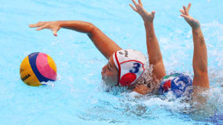 Akari Inaba #3 of Japan competes for the ball against Elisa Queirolo #5 of Italy during their Women's Water Polo Preliminary round match at the Gwangju 2019 FINA World Championships at Nambu University on July 16, 2019 in Gwangju, South Korea. (Photo by Clive Rose/Getty Images)