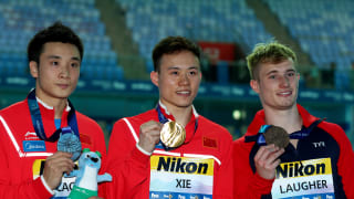 Yuan Cao of China, Siyi Xie of China and Jack Laugher of Great Britain pose during the medal ceremony for the Men's 3m Springboard Final on day seven of the Gwangju 2019 FINA World Championships at Nambu International Aquatics Centre on July 18, 2019 in Gwangju, South Korea. (Photo by Clive Rose/Getty Images)