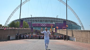 """Olympic Flame visits """"the home of football"""""""