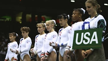 Strug helps 'Magnificent Seven' to gymnastics team gold