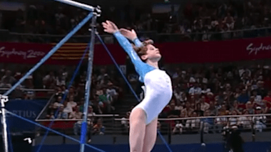 Ekaterina Lobaznyuk performs on uneven bars in team event at Sydney 2000