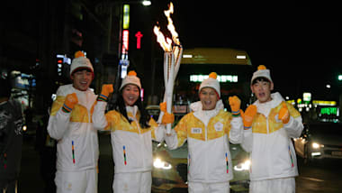 Fireworks and festivities greet the Olympic flame