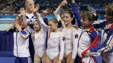 Team Romania on floor in qualifying at Athens 2004