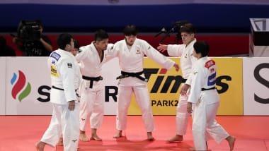 Japan edges France to win third consecutive team world title