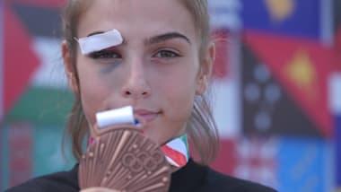 Синяк под глазом - не проблема для первой медалистки из Косово