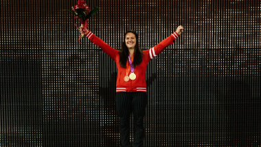 Olympic champion Christine Girard receives re-allocated medals in an emotional ceremony