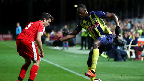 Usain Bolt makes debut for pro football team