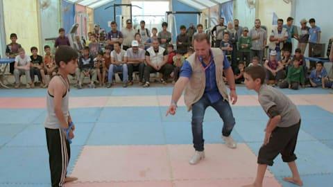 Zaatari: Syrian wrestling champion coaches refugee youth to rekindle hope