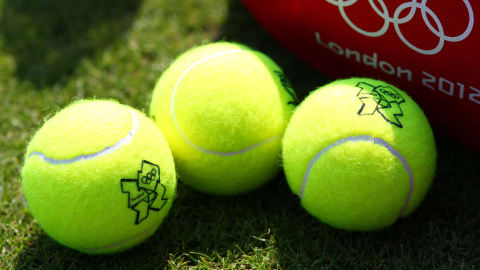 Why the tennis ball is yellow and fuzzy