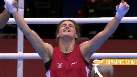 Taylor triumphs as women's boxing debuts