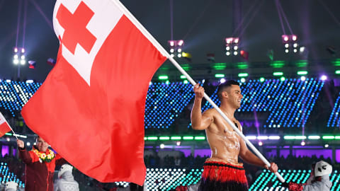 That Tongan flagbearer, he doesn't feel the cold!