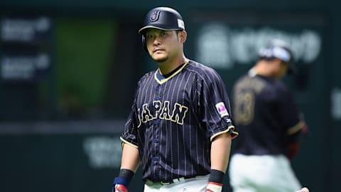 Team Japan's slugger Yoshitomo Tsutsugo digs the long ball