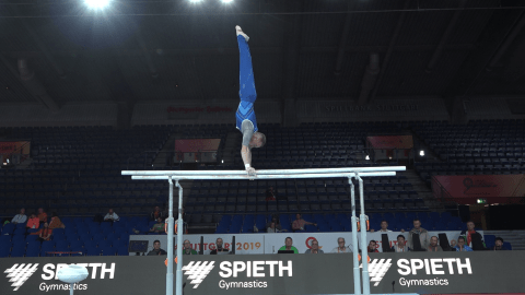Olympic champ Oleg Verniaiev trains on parallel bars at Worlds
