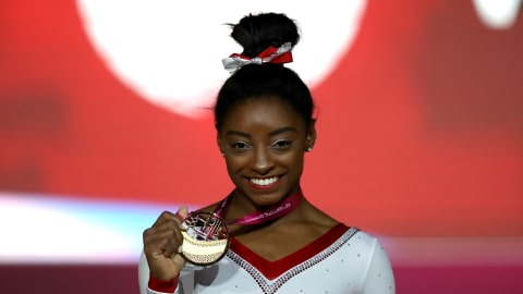 Simone Biles claims historic 13th world title but suffers first defeat in Doha